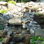 natural stone water feature backyard oasis